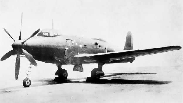 The standard image of the Yokosuka R2Y1 Keiun. It is belived the first scoop on the side of the aircraft provided cooling air for the engine's internal exhaust baffling. The second, larger scoop provided induction air for the turbocharger-less Aichi [Ha-70]  engine in the prototype. The final two ports were for the engine's exhaust.