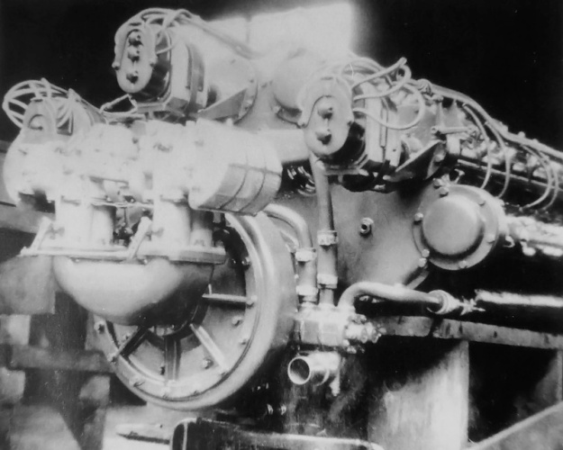 Rear of the 24-cylinder Duesenberg showing two two-barrel carburetors feeding the supercharger. Note the Bosch magnetos mounted driven by the camshafts.
