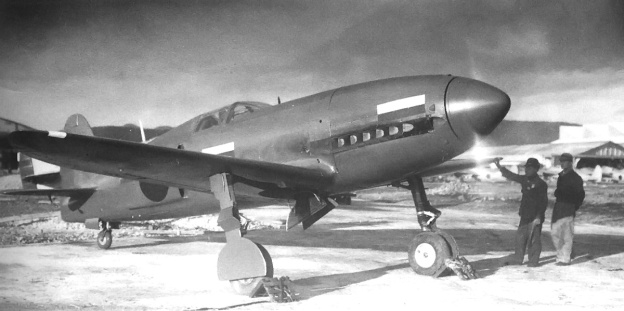 The freshly-painted Ki-78 running-up its DB 601A engine. Note the hinge in the outer gear door to account for extension of the gear strut.
