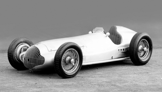 The 1938 Mercedes-Benz W154 Grand Prix racer. Each of the hand-built cars was unique, and they underwent modifications throughout the 1938 race season. For 1939, the nose of the car was extended and a new grille was installed.